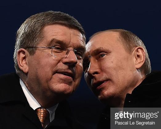 Russian President Vladimir Putin whispering sweet nothings into IOC Presdent Thomas Bach's ear.