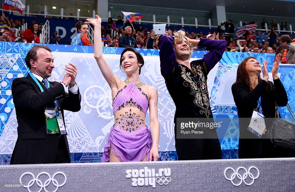 Coaches Oleg Epstein (far left) and Marina Zoueva (far right) applaud U.S. ice dancers Meryl Davis and Charlie White as they received the winning scores at the 2014 Olympics. (Getty Images)
