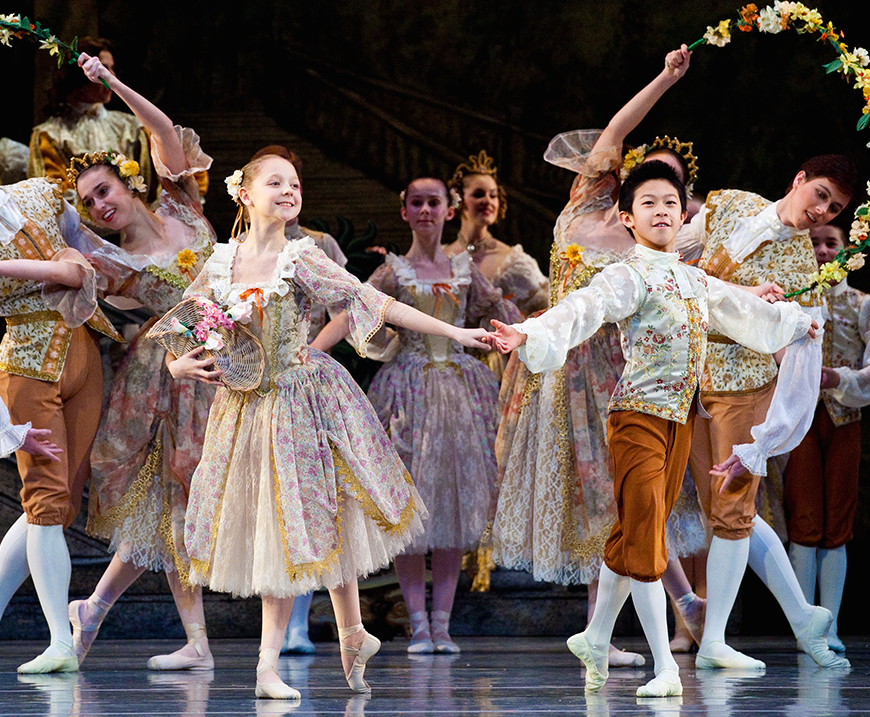 """Madison Young (left, foreground) and Nathan Chen in the garland dance"""" from """"Sleeping Beauty."""" (Luke Isley / courtesy Ballet West)"""