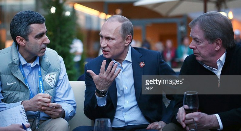 NBC Olympics boss Gary Zenkel, Russian President Vladimir Putin and USOC chairman Larry Probst (l to r) at USA House during the 2014 Sochi Olympics.