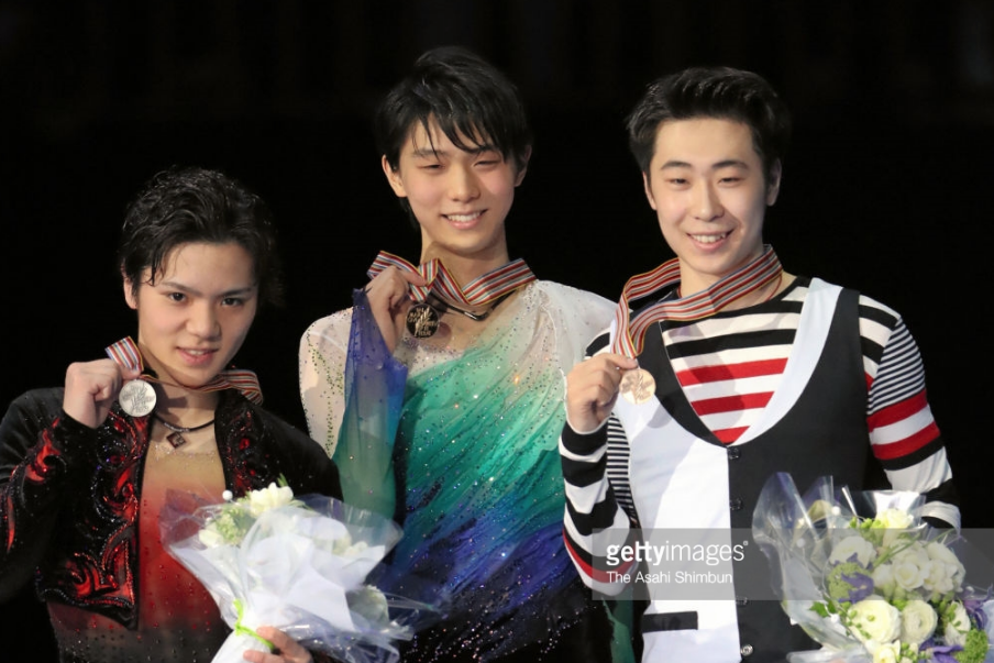 Jin Boyang (right), with Shoma Uno (left) and champion Yuzuru Hanyu at the 2017 worlds, has jumped his way to consecutive world bronze medals.
