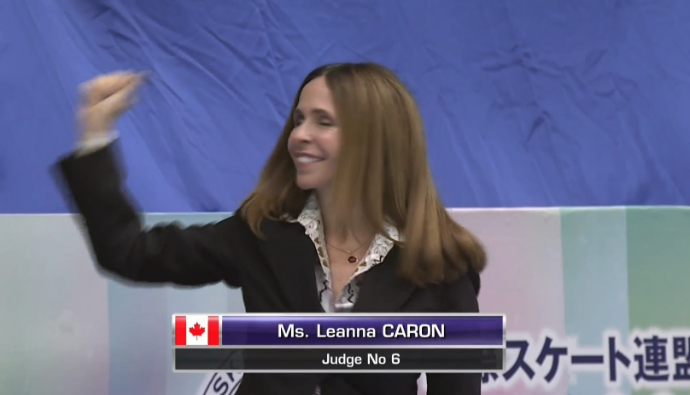 TV screenshot of Leanna Caron as judges announced to crowd at the 2016 NHK Trophy Grand Prix event.