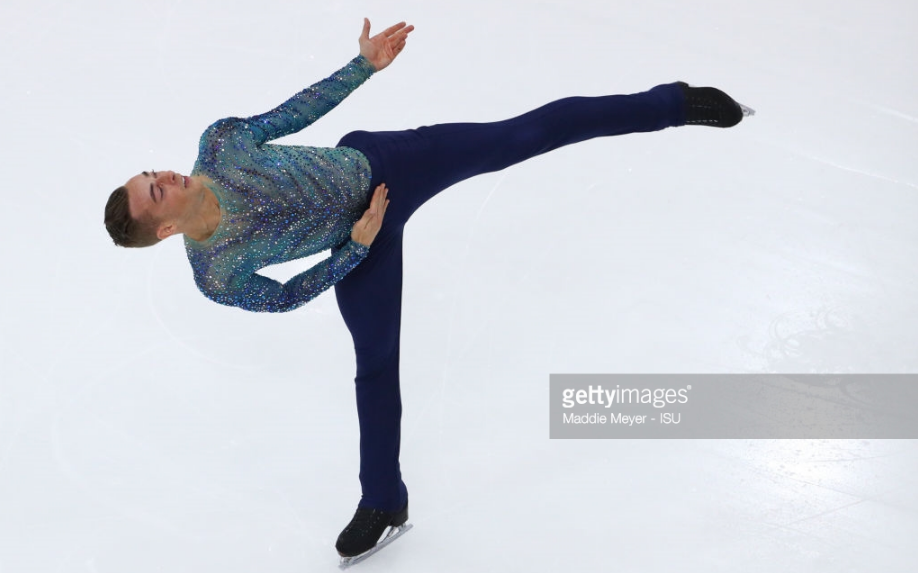 Adam Rippon doing a spin in his striking free skate at Skate America.