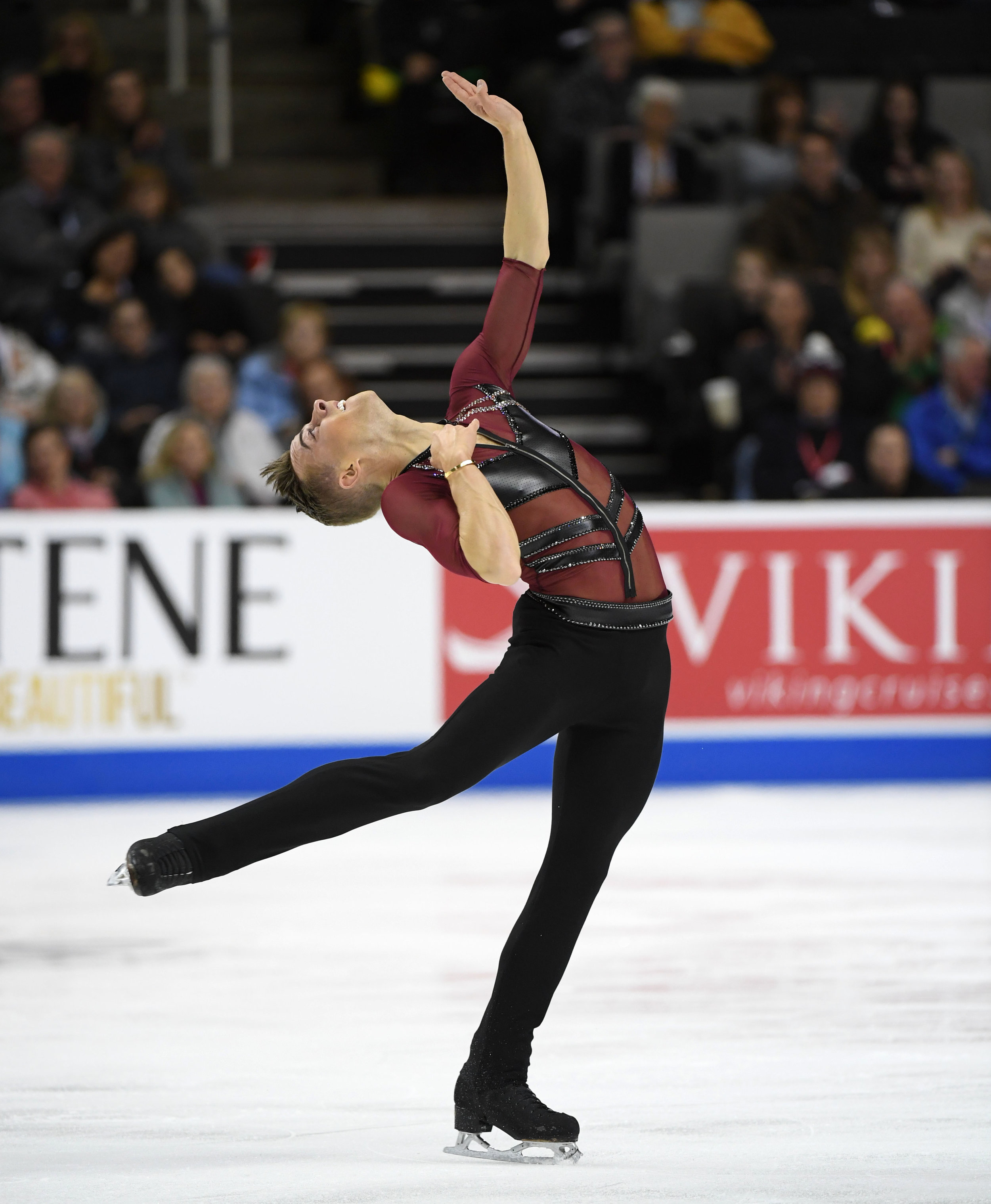 Adam Rippon in an eye-catching spin position. (Jay Adeff / U.S. Figure Skating)