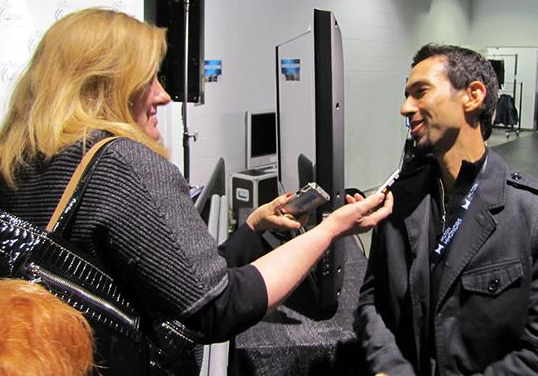 Lynn Rutherford getting insights from Olympic and world ice dance medalist Ben Agosto. (U.S. Figure Skating)