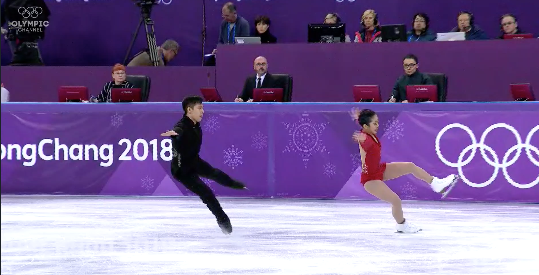 A Chinese judge was suspended for bias that led him to overlook mistakes like this botched landing by Chinese pair Sui Wenjing and Han Cong and place them first in the Olympic free skate. (Screenshot from the Olympic Channel.)