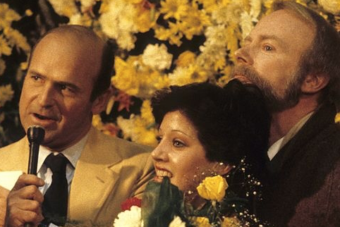Dick Button, Linda Fratianne & Frank Carroll at the 1980 Olympics, where Fratianne won silver. (Getty images)