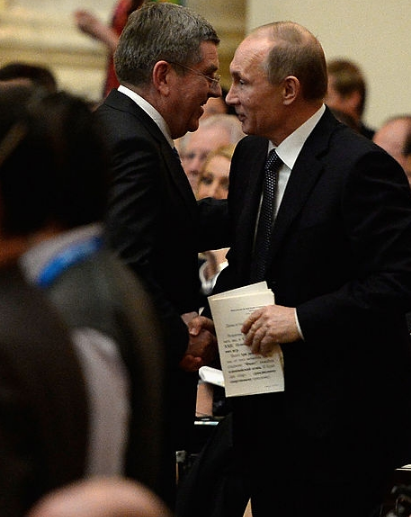 Glad handing, like that between IOC President Thomas Bach (l) and Russian President Vladimir Putin, is a big activity at IOC Sessions. (Getty Images.)