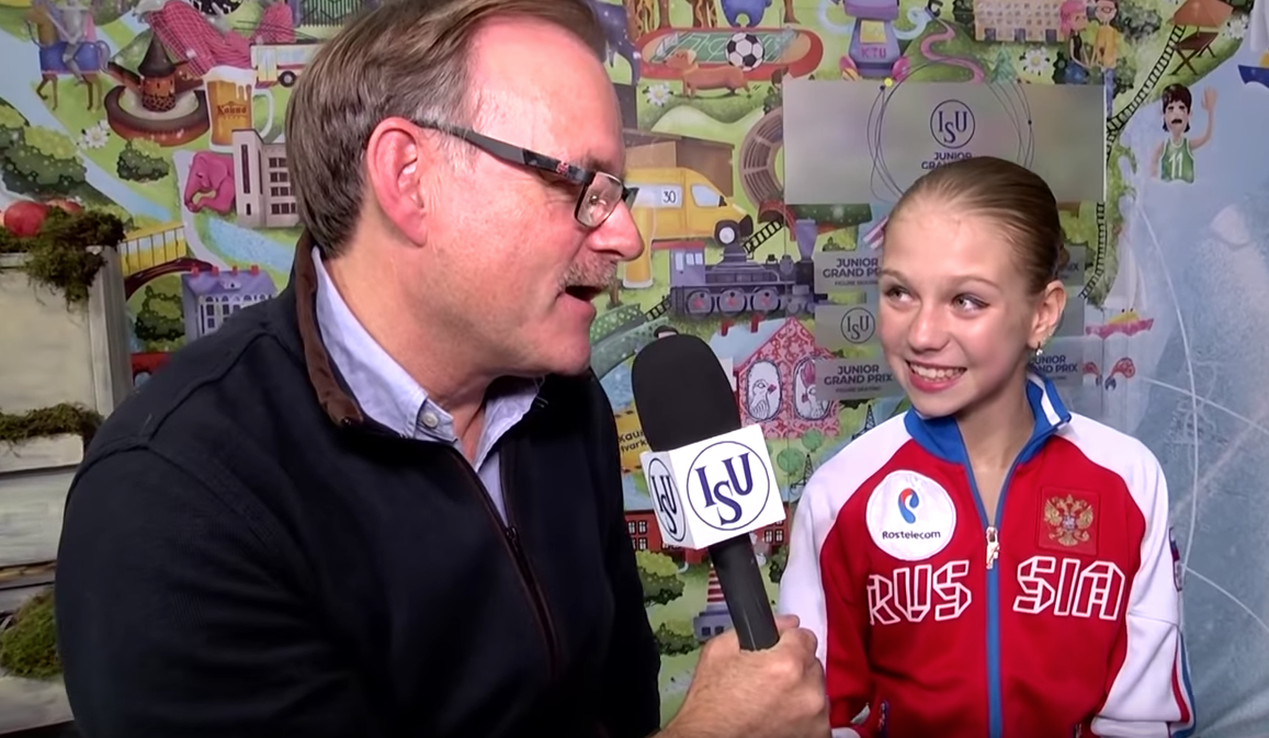 Ted Barton interviewing Russian phenom Alexandra Trusova, 14, after her victory at the Junior Grand Prix in Lithuania this season. (Screenshot from ISU Junior Grand Prix Channel.