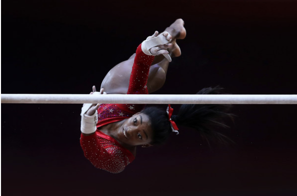 Simone Biles on uneven bars as she led the U.S. to team gold at the World Championships. (Getty Images)