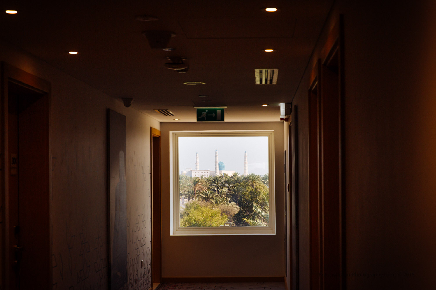 Like a luminous painting hanged on the wall, the Sultan Qaboos Mosque seen from a corridor ar Mercure Hotel (Sohar, Oman).