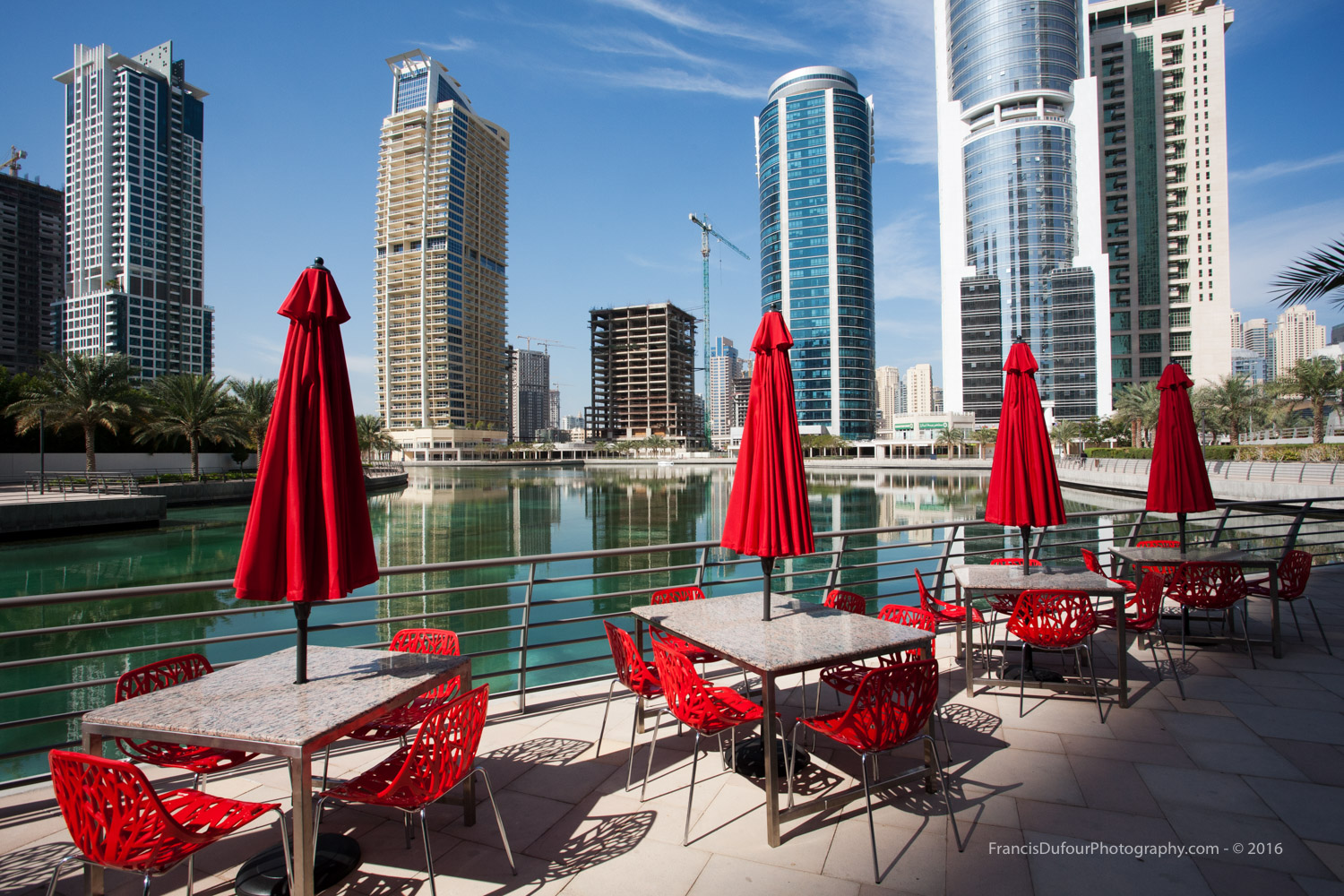 Red chairs and umbrellas in JLT (Dubai, UAE)