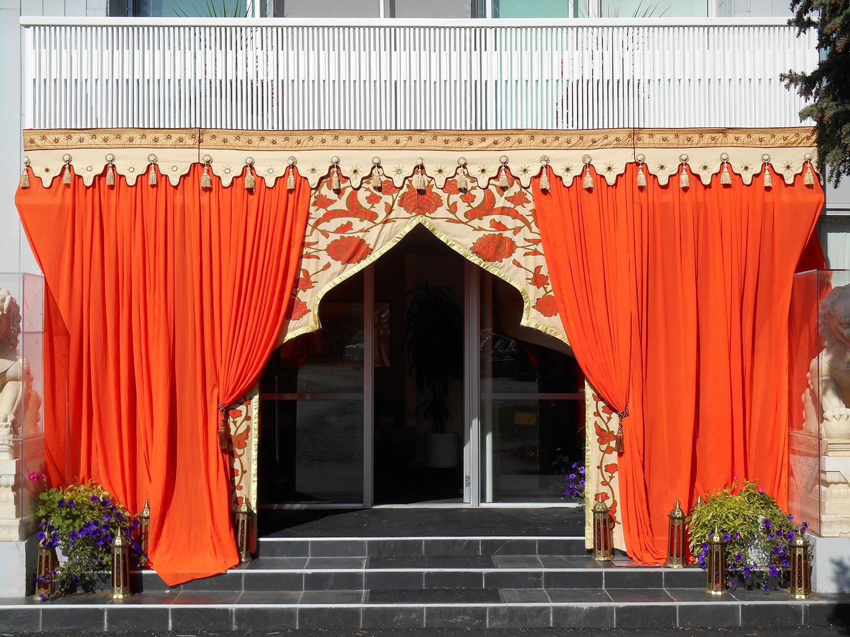 raj-tents-decor-treatment-orange-entrance-arch.jpg