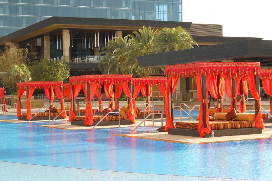 Red and orange Vegas poolside cabanas 6.jpg