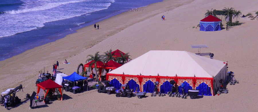 Frame tent outsourced beach stage set.jpg