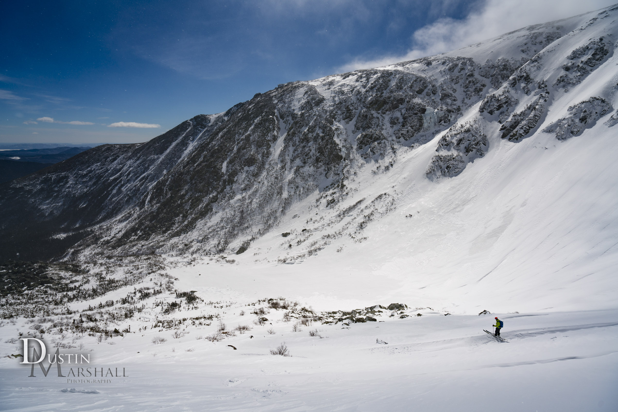 A skier eyes up the bowl in Tuckerman Ravine