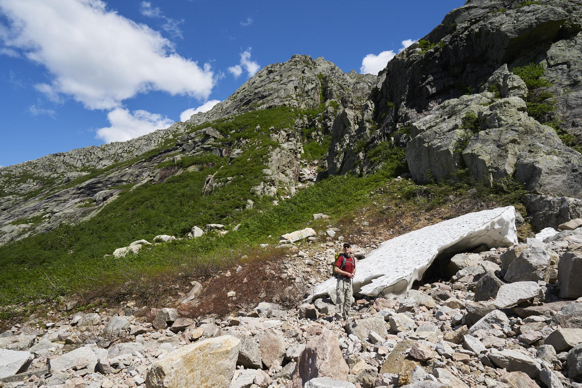Pamola ridge rises through the center-left of the photo.