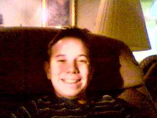 Pictured above: This was probably my AIM profile picture. I found it on an old  tripod website  I made that is apparently still up. Yes, I had to use a flashlight because my webcam was no good at taking photos.