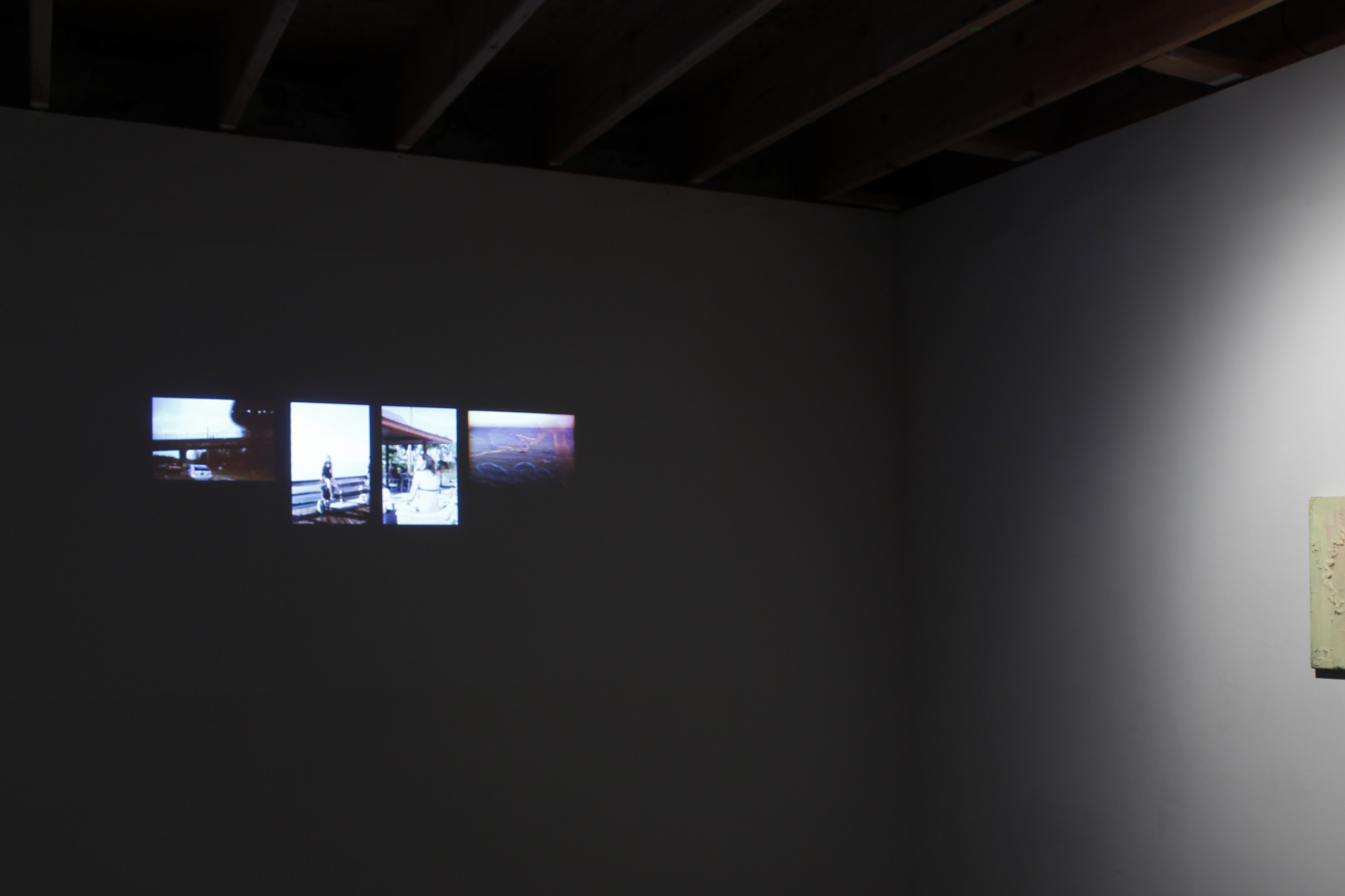 Installation view, Unemployed, 2005-2015, slideshow on single channel projection
