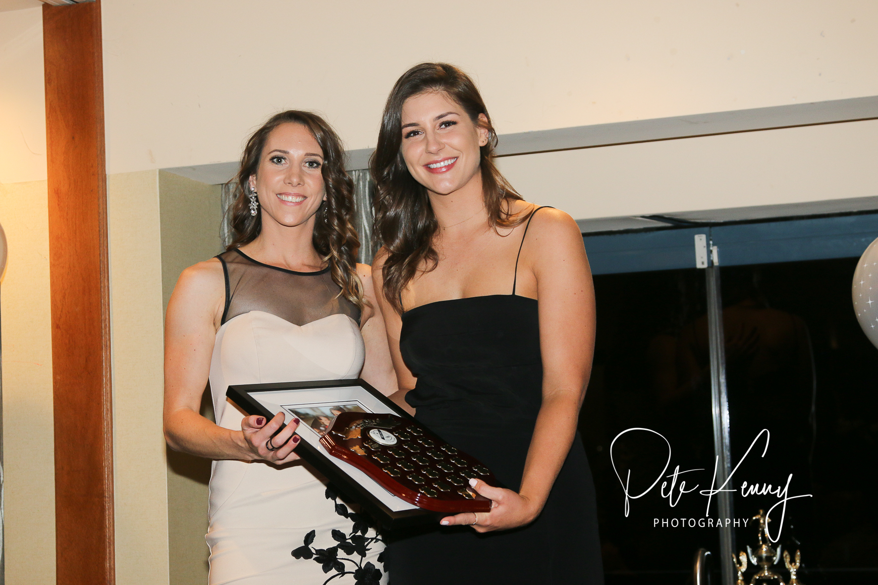 Audrey Legrand (L) received the Women's 1st Grade Players Player for the second year in a row, with Lauren Salmon, Vice Chair of Women's Rugby.