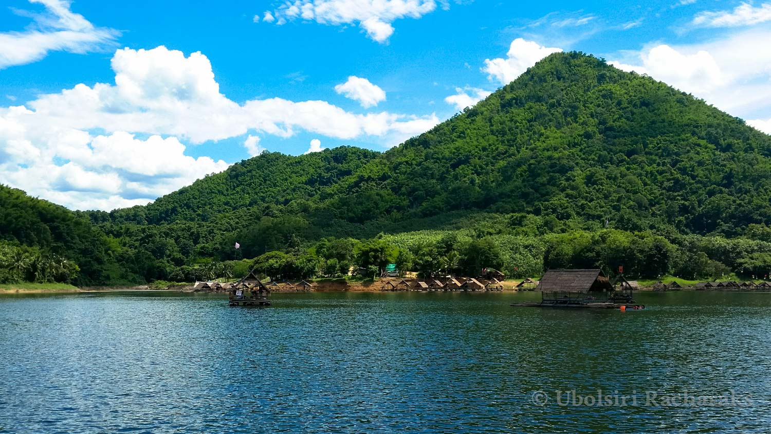 """Huai Krathing Reservoir - It's a little off the route to get to Dan Sai province from the airport, but it's totally worth the extra 20 minutes to the drive! Coming from Loei City, going along Highway 21, turn right at the sign for the reservoir.Originally just for irrigation, the locals have made it a relaxing local spot to eat. There seems to be a few different spots available for lunch, but the one we went to was """"แพพ่อบ้านระเริงชถ"""" or """"Phaa paw-baan ra reung chot"""" which literally translates to something along the lines of """"Cheerful Rafting House"""" or how they have it on their English menu: """"Head of the household raft rejoices the water"""".They had a flat fee of 200 THB or so (depends on the group size) to rent out the entire raft for as long as you wanted and then add the cost of whatever food and drinks you order. You're also welcome to get out into the water. If you're not a strong swimmer, they provide life jackets too.Phone number: 0808109313"""