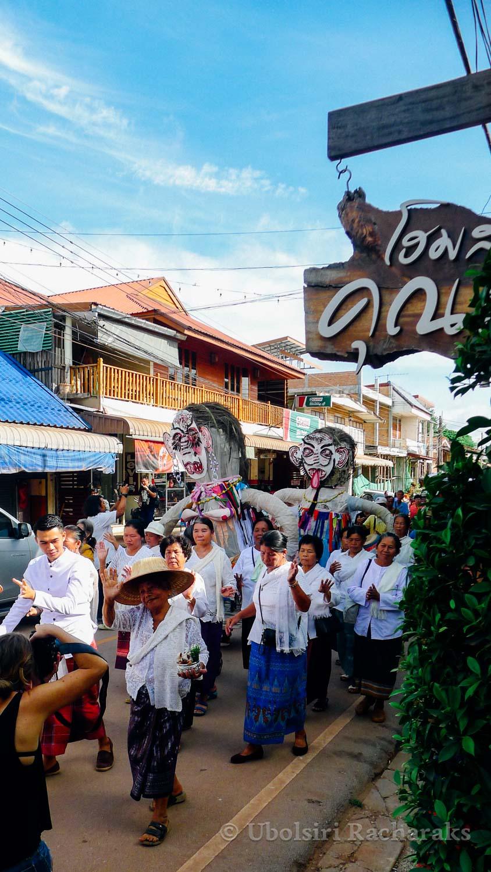 Giant Phi Tha Khon Figures Coming Down the street