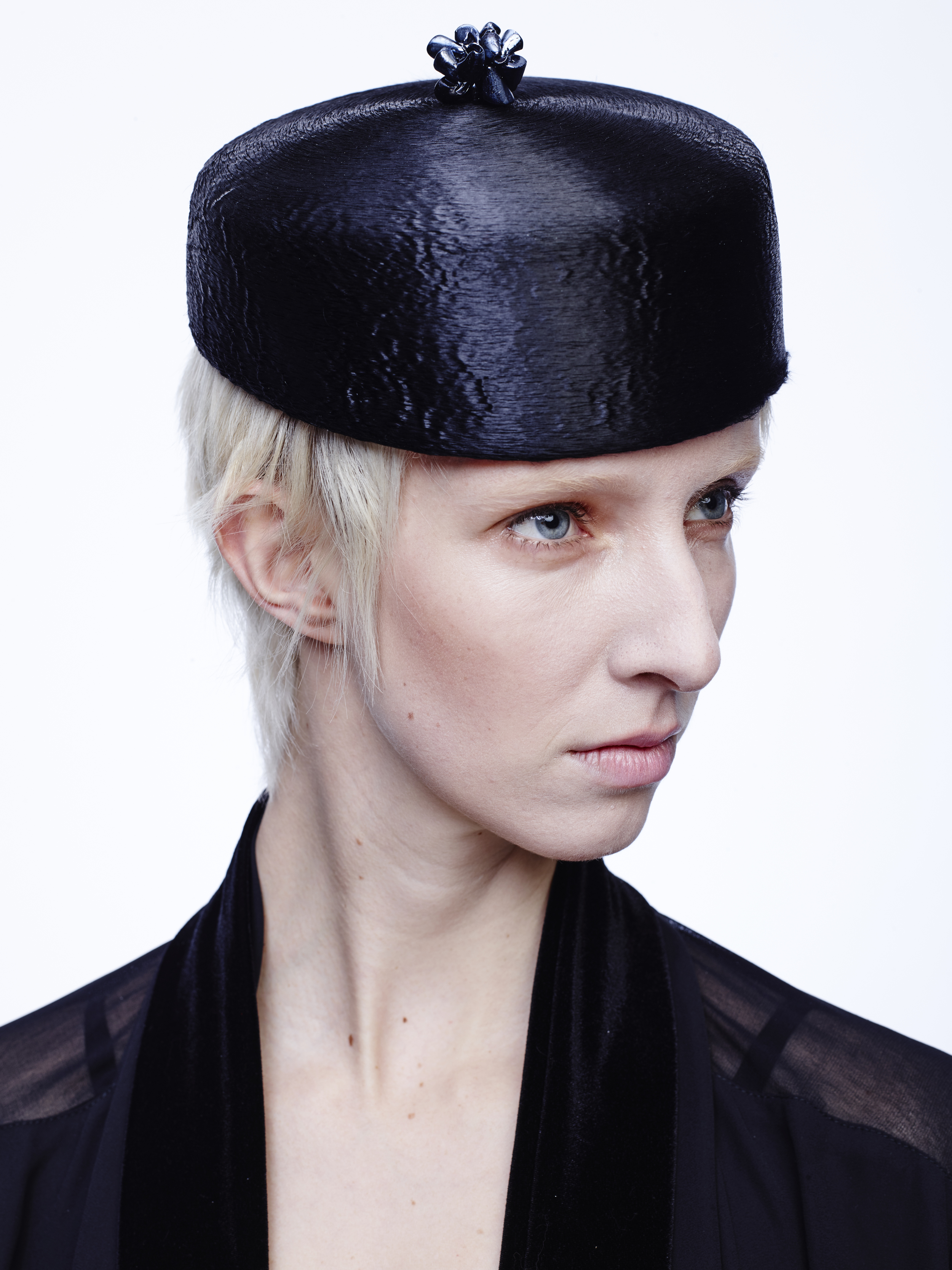 Polished antique meluzine cocktail hat with chrome plated shell cluster.