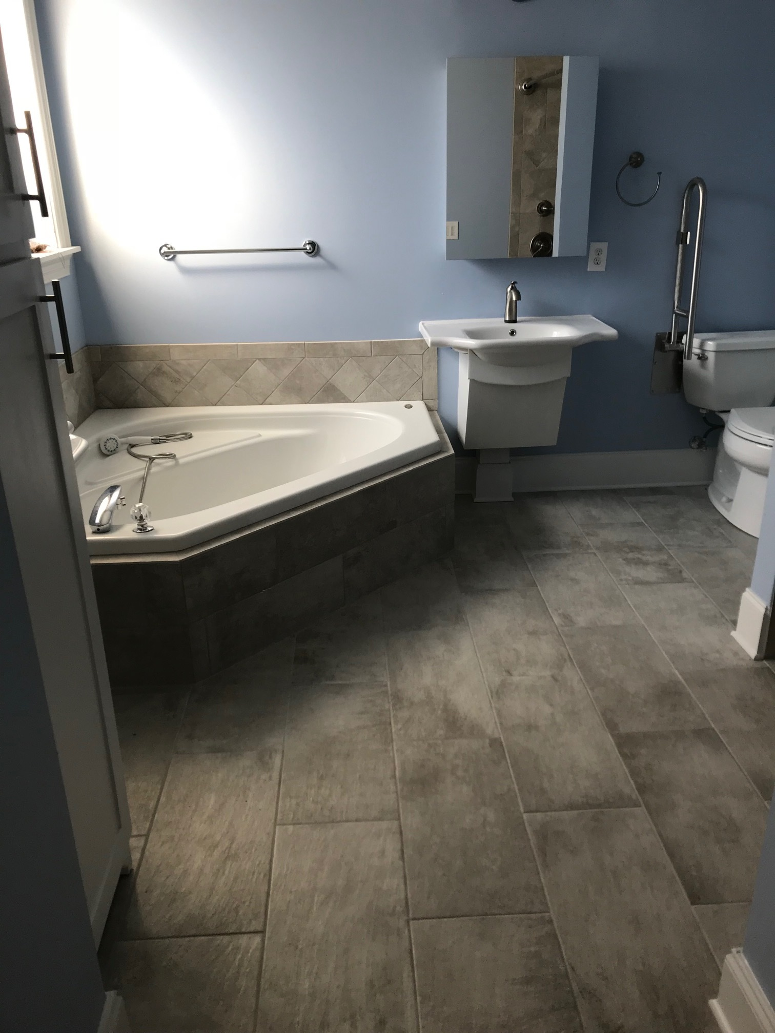 Large format tile bath floor