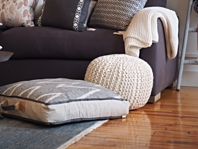 Color block your throws with your pouf to help them blend into the room.