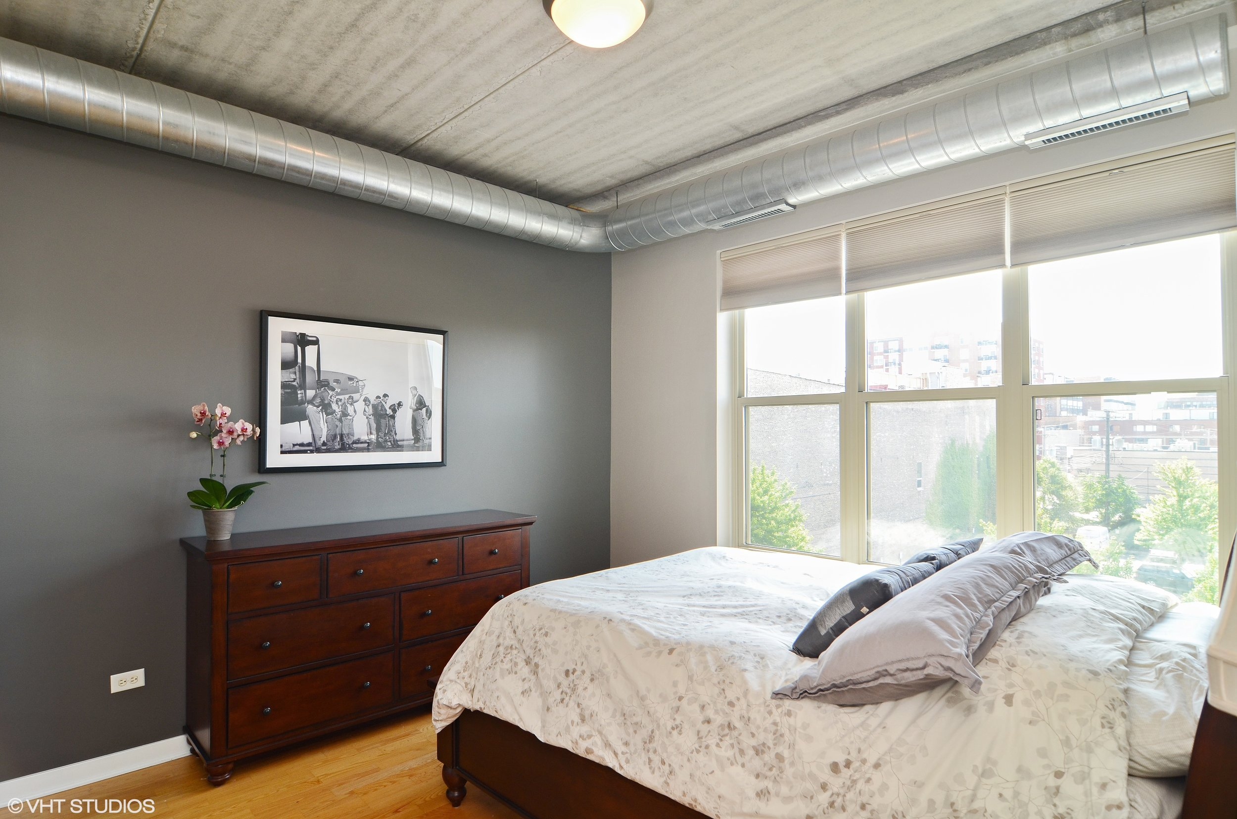3_1228WMonroe_401_14_MasterBedroom_HiRes.jpg