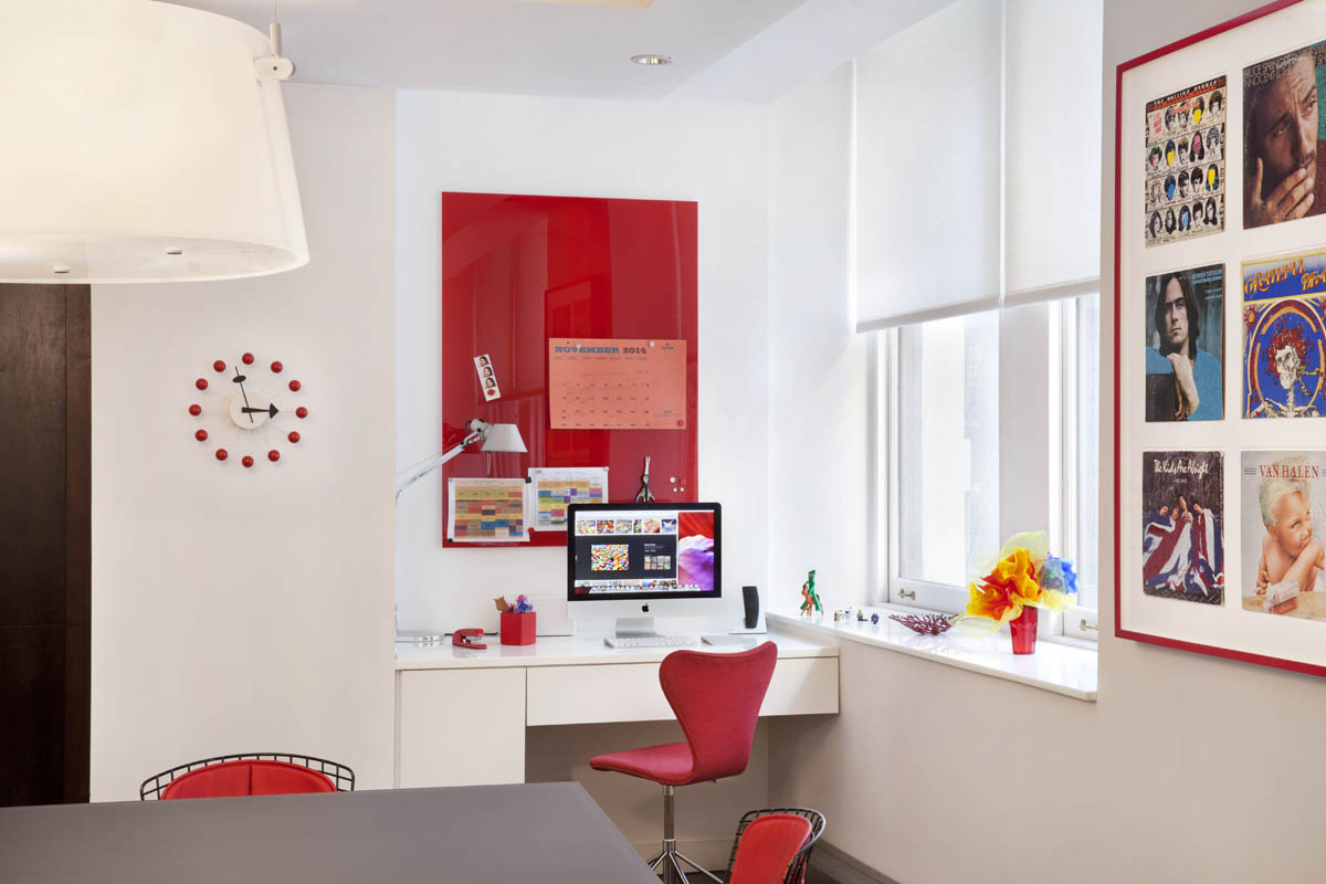 Red accents and very special rock vinyl art punctuate the kitchen. The inspiration for another  blog post .