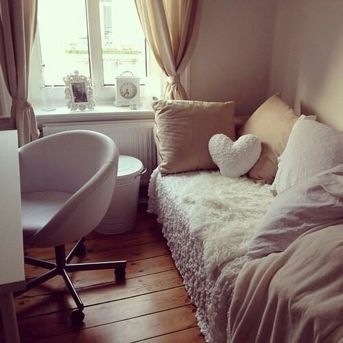 Found on  Stylcaster.com the simple round chair in this room adds an extra layer of softness