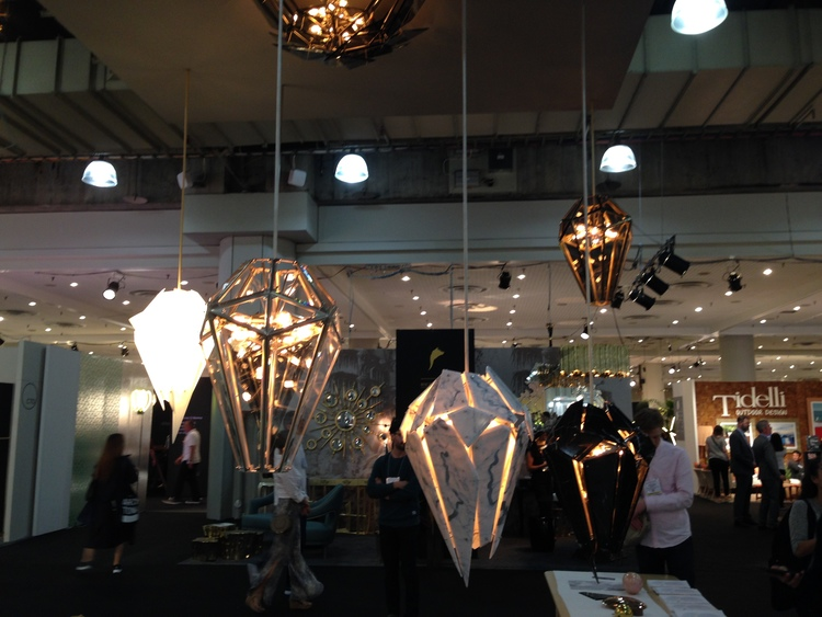 Lindsey Adelman Studio , frequently associated with organic Bubble chandeliers and installations, highlighted their highly geometric Edie designs.