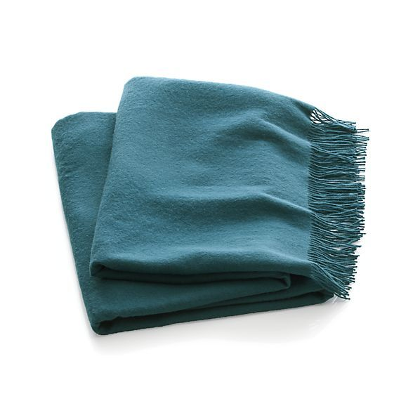 Available in a smaller selection of hues, but very accessible in price, Crate and Barrel's Lima throws are made in Peru.  via  crateandbarrel.com