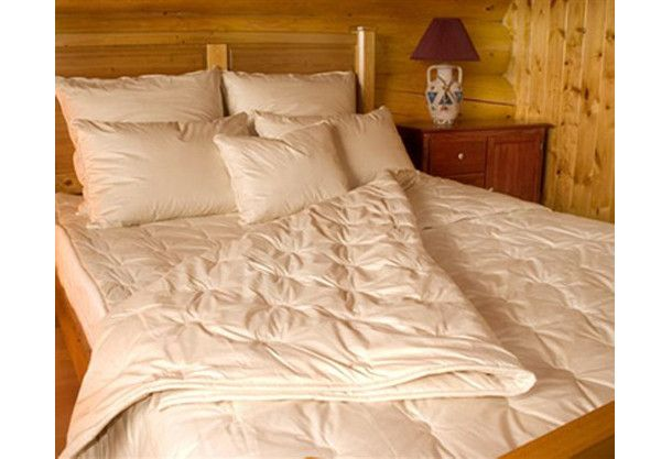 Comforter filled with organic alpaca is winter weight cozy.  via  satarahome.com