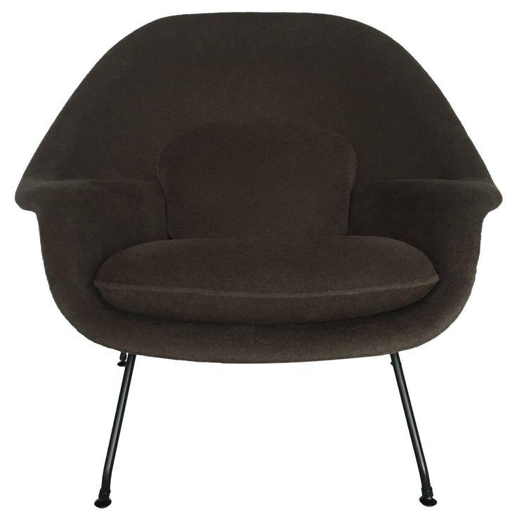 A vintage Saarinen Womb Chair, newly reupholstered with alpaca.  via  1stdibs.com