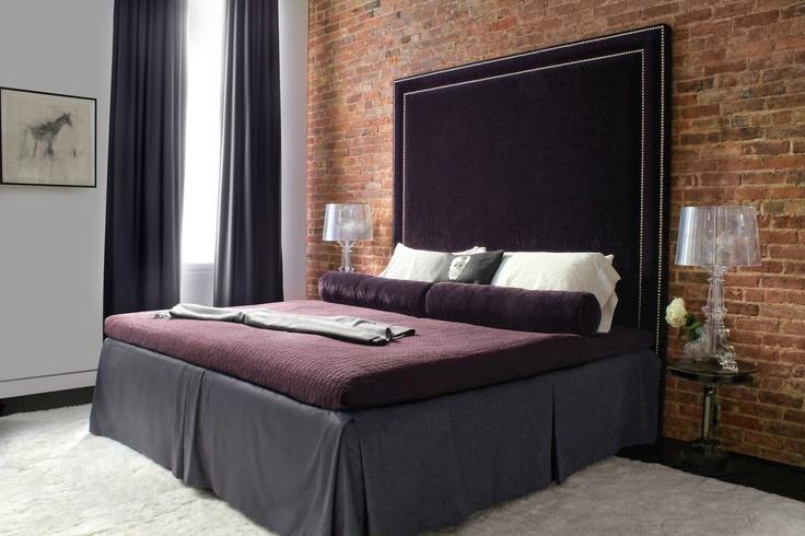 I used a deep, alpaca rug in my client's master bedroom as a soft and sexy contrast to the plush eggplant velvet headboard. via  tamarahubinskyinteriors.com