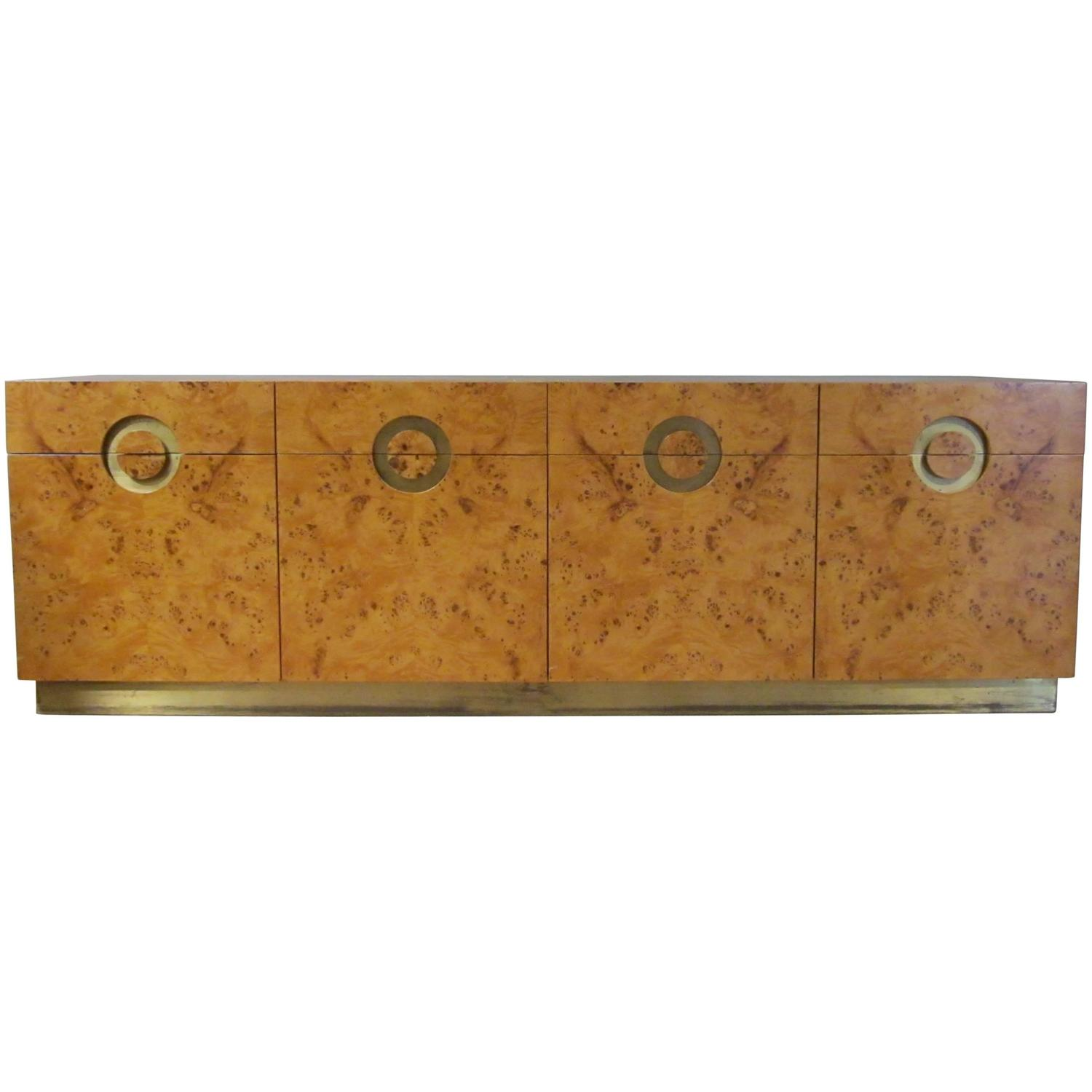 Designed by Willy Rizzo in the 1970s, a four door  credenza  with burl birchwood and brass accents.