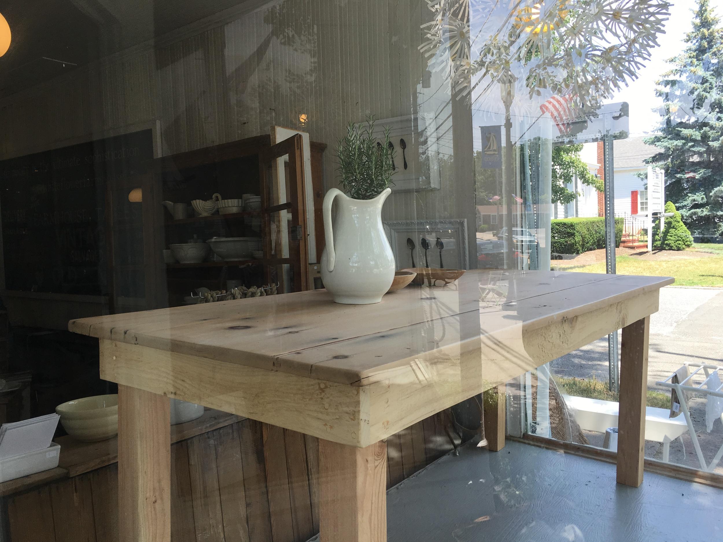 A white jug, fresh herbs and a Main Street view