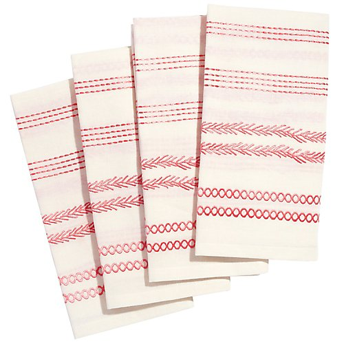 Cloth napkins are perfectly functional. Pink embroidered napkins are perfectly frivolous.  John Robshaw, via Gracious Home.