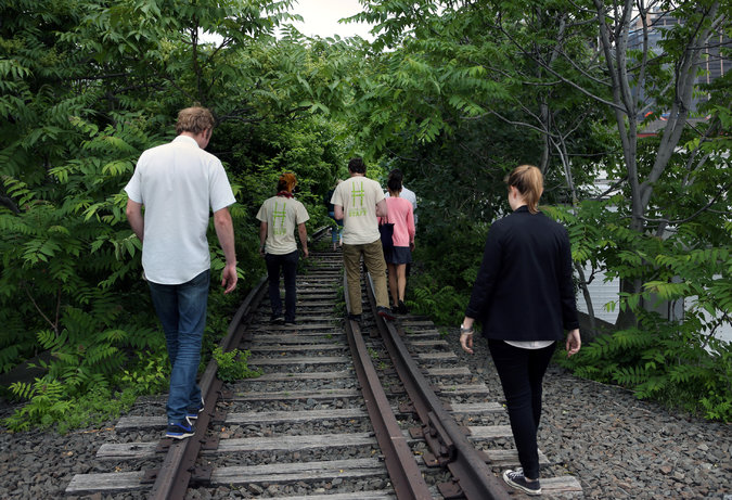 Visitors to the northern portion of the High Line next to Hudson Yards, prior to its public opening, in 2013, via  NYTimes .