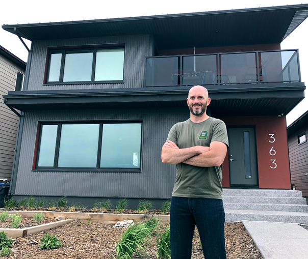 Brian Sexton, standing in front of his NZE Ready House in Lethbridge, Alberta