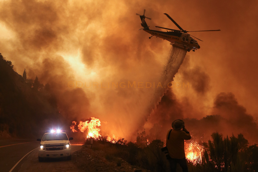 LACoFD Copter 19 makes a water drop as flames encroach upon hand crews along Soledad Canyon Road outside Action, CA on July 24, 2016. © Craig Durling / Durling Media