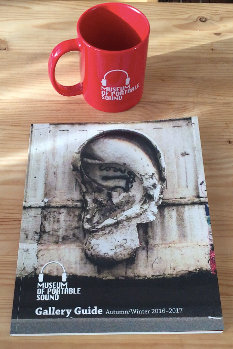 The Museum's official mug and the first edition of its Gallery Guide book