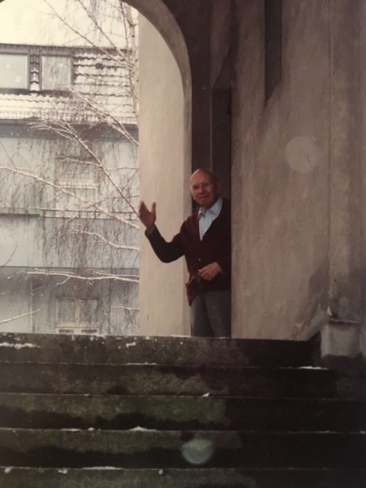 Uropa waving to us from his hallway - this is how I remember him - jolly and kind.