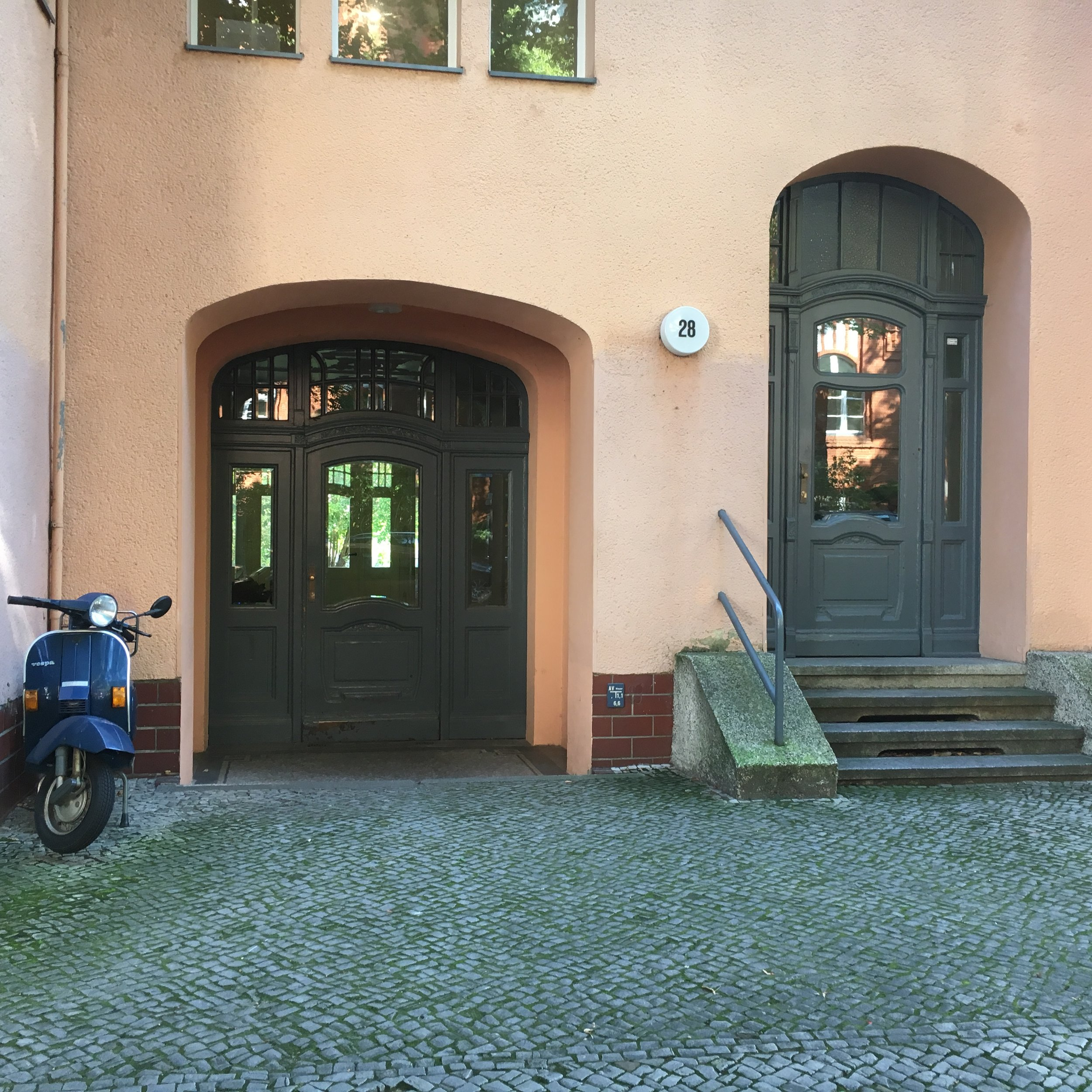 The view from the street of my Uropa's apartment. We always entered through the left door into the inner courtyard.
