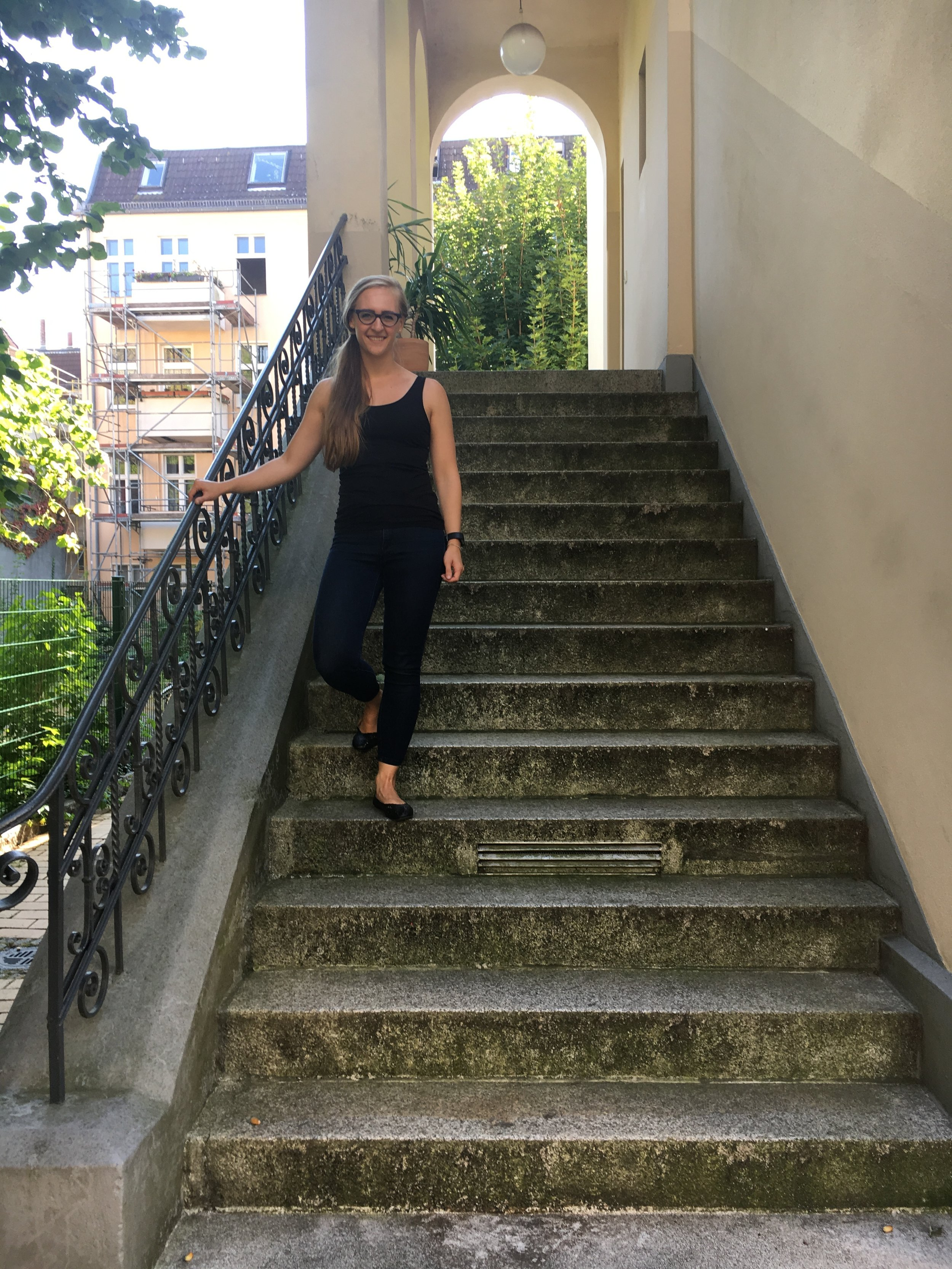 Standing on the steps that lead up to Uropa's old apartment.