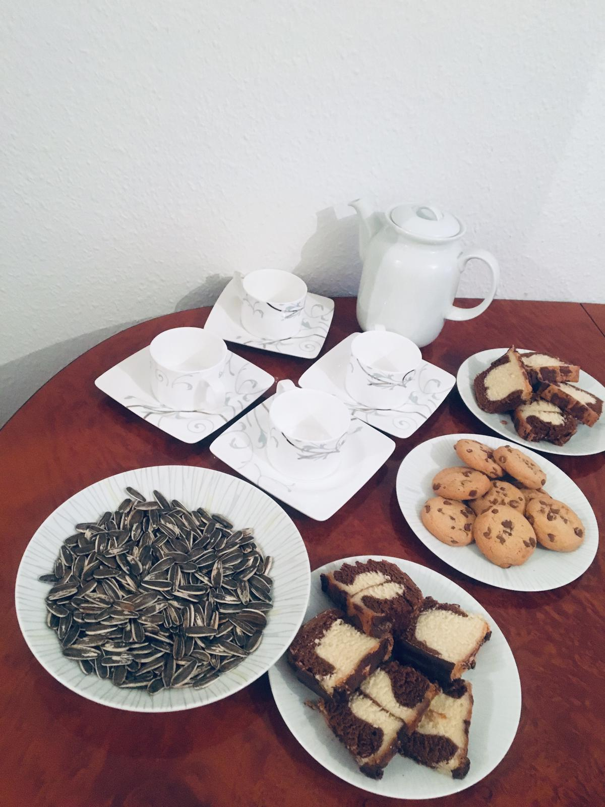 Our gracious hostess brewed Arabic-style tea, served sweet cake and cookies and salty sunflower seeds.