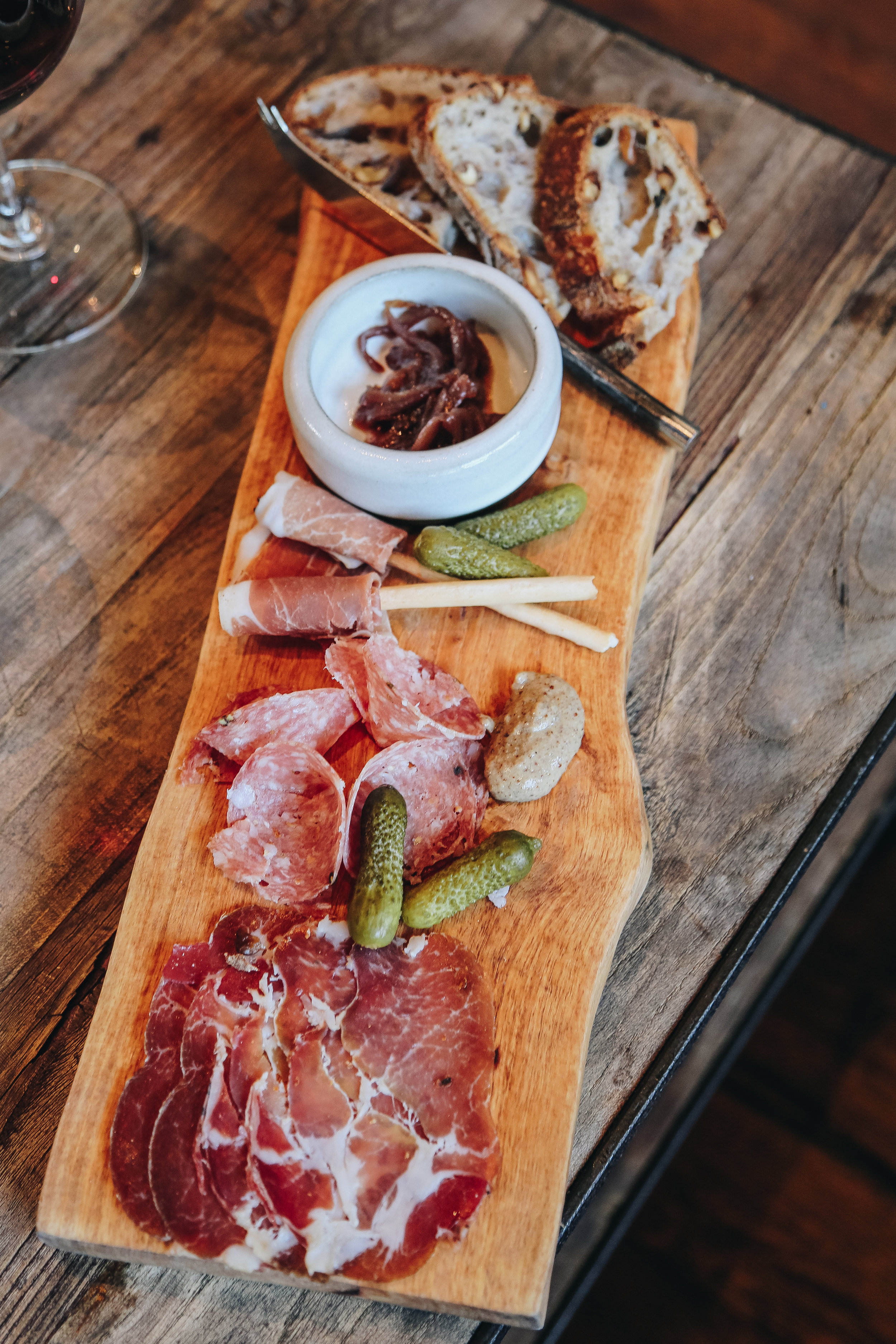 Red & Charcuterie Flight - Zoe's Dry Cured Coppa, Finocchiona & Prosciutto Wrapped Breadstick, Mustard, Girl & the Fig Red Onion Confit, Cornichon, Model Bakery Walnut Bread   Wine Pairings -2014 Pinot Noir, Charles Vineyard* | 2013 Zinfandel | 2013 Cabernet Sauvignon