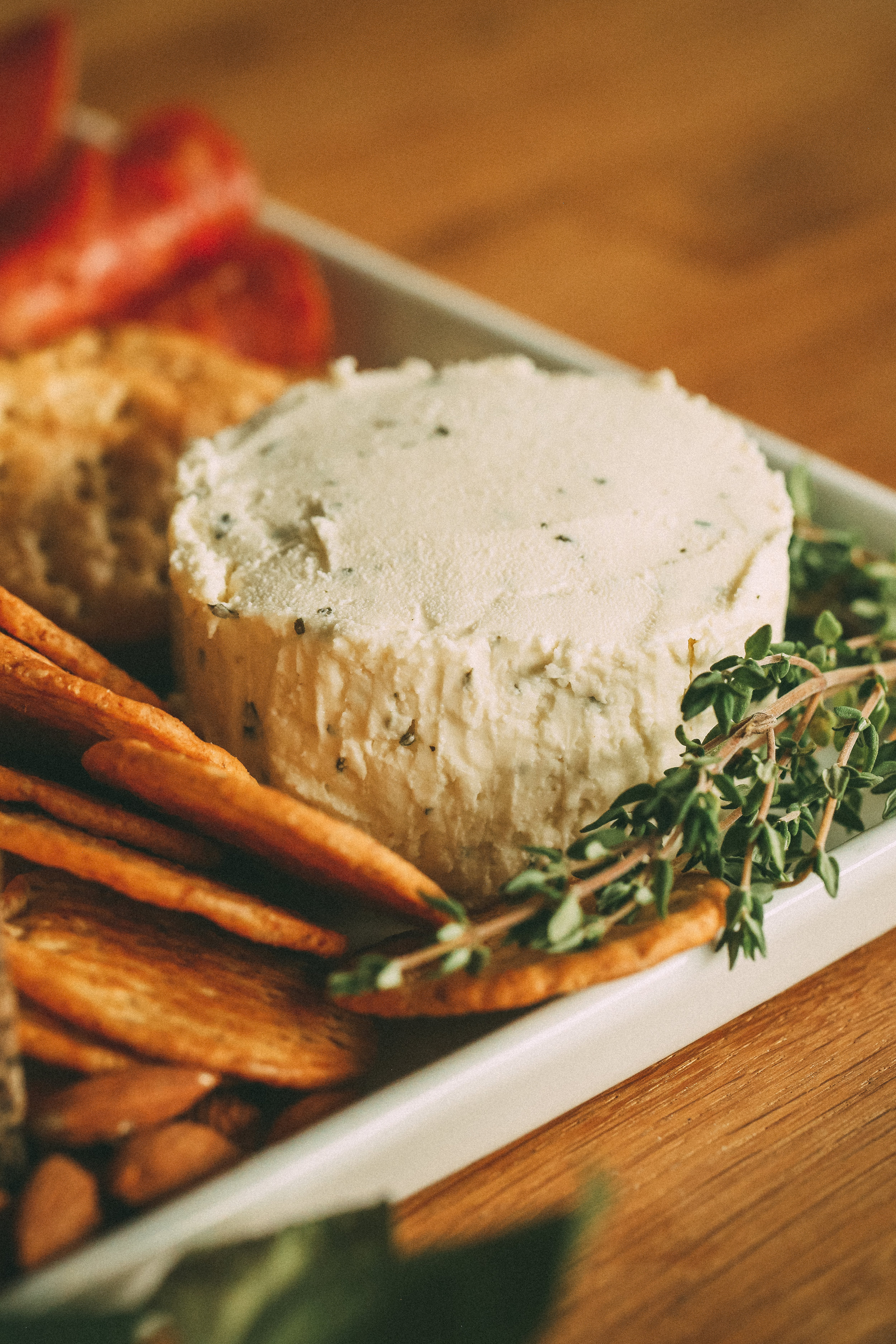 Boursin -A soft, spreadable, garlic and herb cheese. This one is always a crowd pleaser and the first to disappear